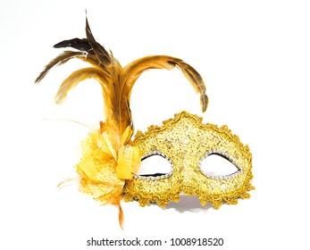 Gold fancy mask on white background
