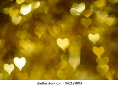 Gold festive background bokeh hearts