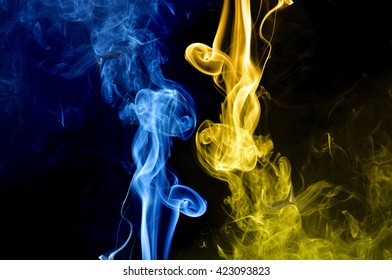 gold fire and blue fire background, abstract blue and gold smoke on black background