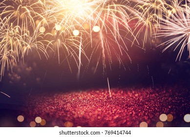 Gold Fireworks and red bokeh in New Year eve and copy space. Abstract background holiday.