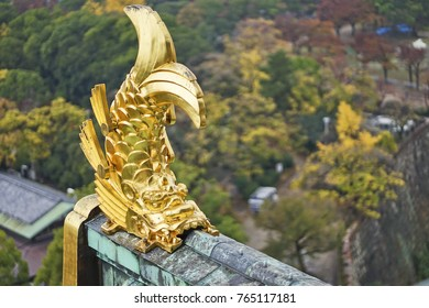 Gold fish sculpture on the top in Osaka Castle.