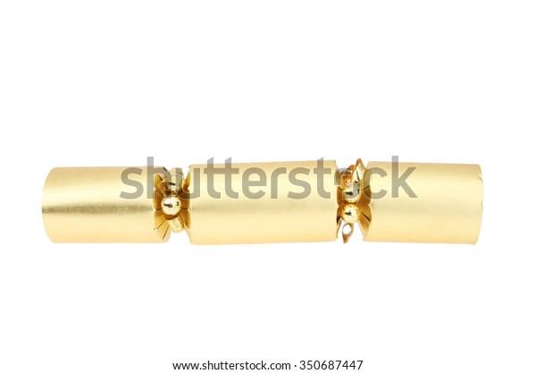 Gold foil Christmas cracker isolated against white