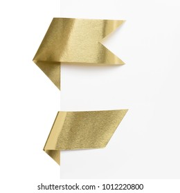 Gold foil label ribbons on white paper corner border isolated