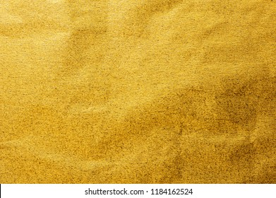 Gold foil leaf metallic wrapping paper shiny texture background