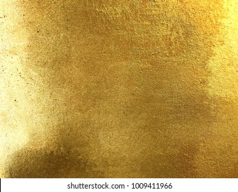 Gold or foil on dirty background texture