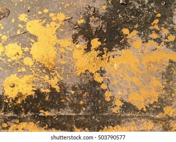 Gold or foil painting on grunge concrete and cement dirty for texture background