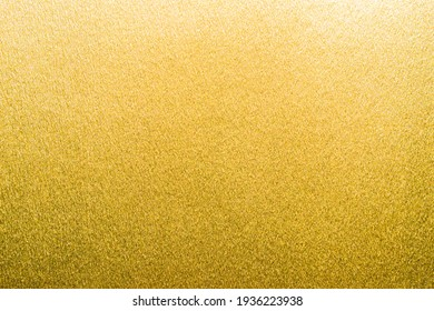 Gold foil texture background metallic golden shinny wrapping paper bright yellow wall paper for design decoration element