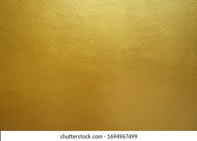 Gold foil texture background sparkly filled with shiny gold glitter in Thailand.