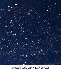 Gold fragments on dark background Festive star universe background
