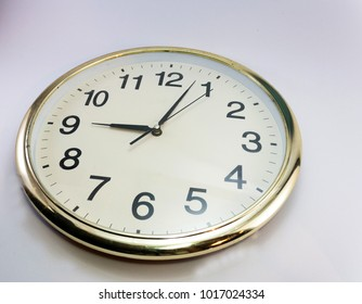 Gold frame clock on white background