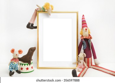 Gold frame mock-up, and white wall with toys.mouse, circus. Place work