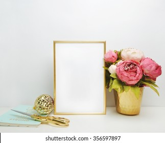 Gold frame mock-up, and white wall with gold vase, and peonies Place work