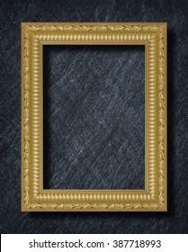 gold frame on black slate background