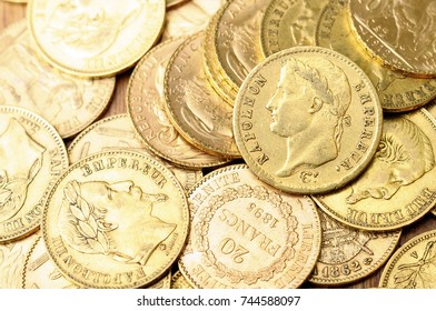 Gold french coin, Napoleon, on wooden table