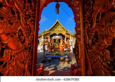 Gold Gate entrance of thai lanna temple of Wat Ming Muang, Chiang Rai, Thailand