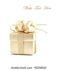 Gold gift box over white background