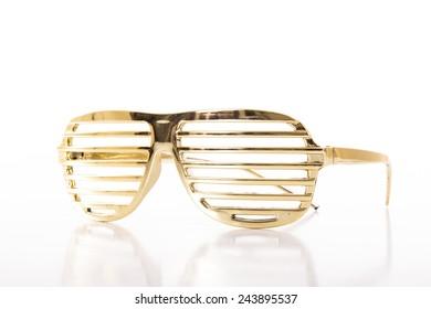 Gold glasses on white background