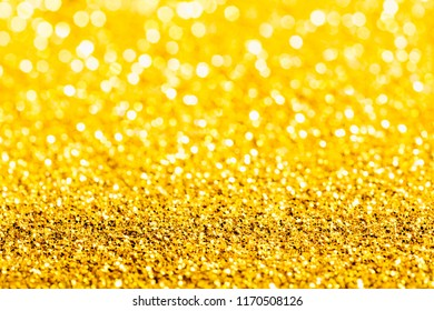 Gold glitter macro close-up texture with shallow depth of field and bokeh background, luxury value concept for christmas or birthday greetings and presents