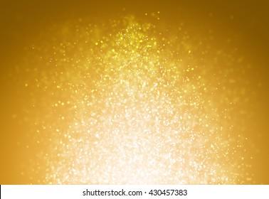 Gold glitter sparkles rays lights bokeh Festive Christmas Elegant abstract background.