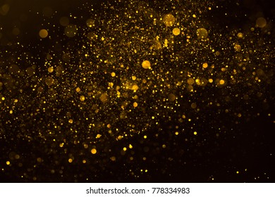 Gold glitter stardust explosion wave abstract background