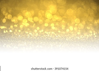 Gold glitter surface with gold light booked with white copyspace- It can be used for background for special occasions promotion campaign or product display