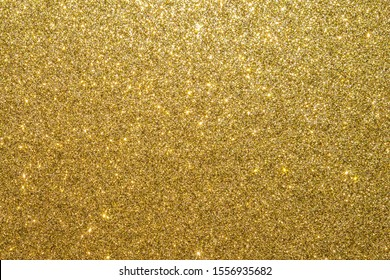 Gold glitter texture background sparkling shiny wrapping paper for Christmas holiday seasonal wallpaper  decoration, greeting and wedding invitation card design element - Shutterstock ID 1556935682
