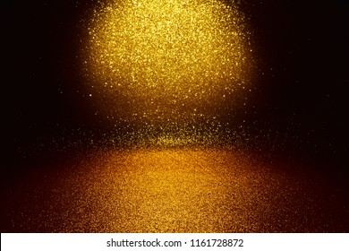 Gold glitter vintage lights texture background. defocused - studio