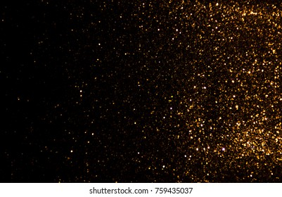 Gold glitter vintage lights texture background Christmas. defocused