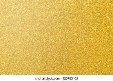 Gold glittering foil leaf shiny wrapping paper glitter texture background for Christmas holiday seasonal wallpaper decoration and greeting card design element