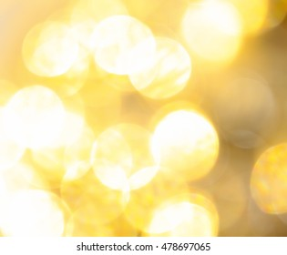 gold glittering in the rays of the sun in the blur for the background