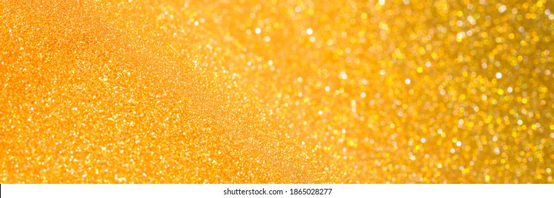 Gold and golden yellow glitter bokeh circle glow  blurred and blur abstract. Glittering shimmer bright luxury . White and silver glisten twinkle for texture wallpaper and background backdrop.