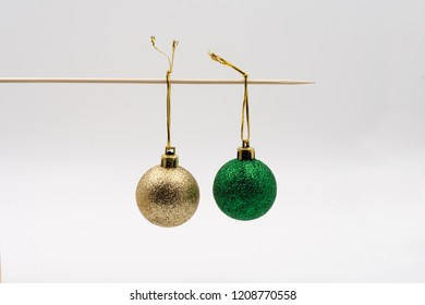 Gold and green ball on a stick.