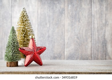 Gold and green christmas tree on a wooden background.