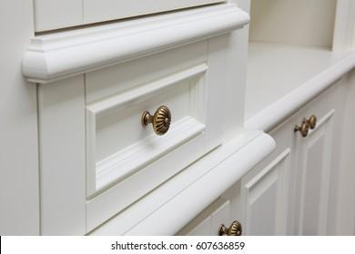 gold handles on cabinet doors.