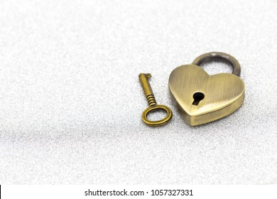 fc85e7bc09 Gold heart padlock and key on white glitter background for valentines day  with copy space
