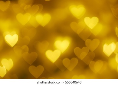 Gold heart shape bokeh background
