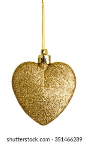 Gold heart tree ornament. A Christmas sparkling bauble on string could be used for valentine project isolated.