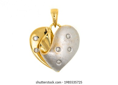 Gold heart-shaped pendant. The jewelry is isolated on a white background. Falling in love. Expensive jewelry, precious