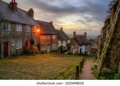 GOLD HILL SHAFTESBURY, UK - DECEMBER 14, 2013: Landscape image of Winter sunrise over Gold Hill in Dorset, famous as a typical old English village scene
