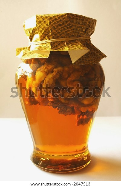 Gold honey with walnuts, isolated
