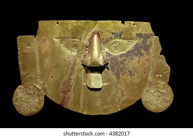 Gold Inca mask with black background