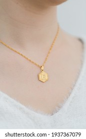 Gold initial necklace on model