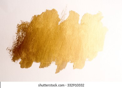 Gold ink texture paint . Shining brush background