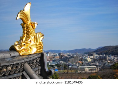 Gold Japanese fish statue on rooftop of Okayama castle in Okayama city, Japan. Believed that it can prevent fire accident.