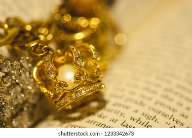 Gold jewelry against text with bokeh