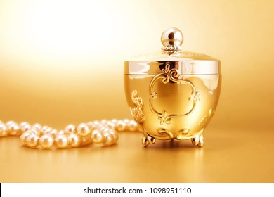 gold jewelry box gold background and pearls