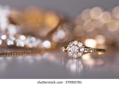 Gold jewelry and bright bokeh.
