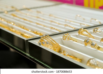 Gold jewelry diamond shop with rings, bracelet  and necklaces luxury retail store window display