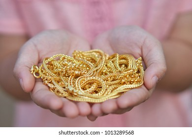 gold jewelry in lady hands.
