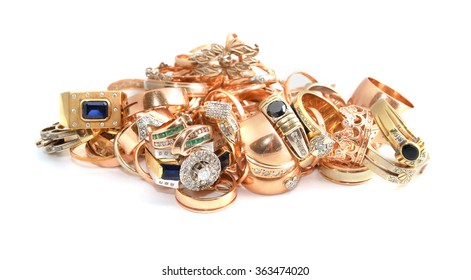 gold jewelry on a light background